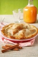 Whole Apple Pie; Cinnamon Sticks; Jug of Apple Cider