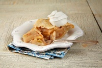 Piece of Apple Pie with Whipped Cream and a Fork