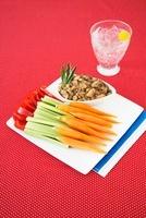 Fresh Veggies and Bean Dip on a Platter; Glass of Seltzer Wa
