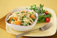 Farfalle Pasta with Peas and Squash in a Bowl; Fork; Side Sa