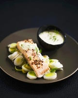 Steamed salmon fillet on sliced leeks with curry sauce
