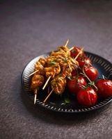 Chicken sate kebabs with tomatoes