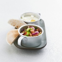 Coddled egg with vegetable salad and pita bread