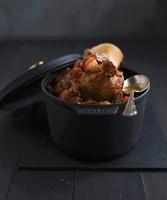 Braised veal knuckle with mushrooms