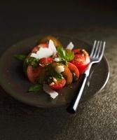 Tomato salad with pesto and parmesan