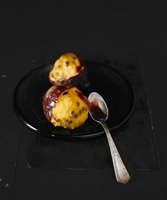 Passion fruit ice cream with fruit sauce