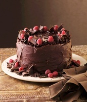 Whole Chocolate Cake with Raspberries and Chocolate Shavings