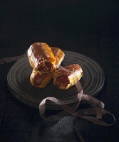 Eclairs with chocolate filling and chocolate glaze