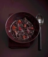 Wild boar in red wine with cranberries