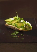 Poppy seed baguette with cucumber, avocado, kiwi and coriand