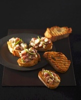 Toasted baguette slices topped with tuna tartar