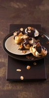 Profiteroles with chocolate glaze and slivered almonds