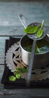 Chicken soup with tea and herbs