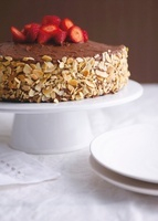 Chocolate cake with flaked almonds and strawberries