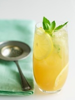 Tall Glass of Jasmine Iced Tea with Lemon and Mint; Tea Stra