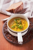 Cream of carrot soup with ginger and orange zest