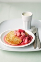 A pancake with rhubarb compote