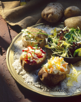 Baked potatoes with various soft cheese fillings
