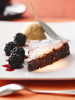Chocolate cake with blackberries and chestnut ice cream