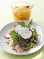 Summer salad with goat's cheese and walnuts with apricot an