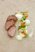 Glazed pork fillet with spring vegetables and parsley foam