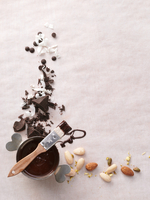 Chocolate sauce, chocolate pieces and almonds