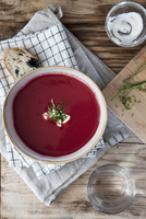 Cream of beetroot soup with olive bread