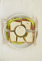 A Decoratively Cut Ham and Cheese Sandwich with a Paper Fork 22199073358| 写真素材・ストックフォト・画像・イラスト素材|アマナイメージズ