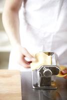 Running Sheets of Pasta Through a Pasta Machine