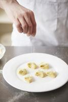 Preparing Tortelloni