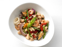 Bean salad with seafood and basil