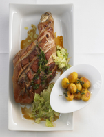 Marinated chocon de lait with cabbage and potatoes
