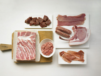 Various types of pork - sausages and ham