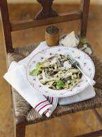 Pasta with mushrooms, carbonara sauce and Parmesan cheese