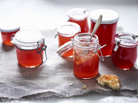 Quince jelly in jars and on bread
