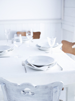 A table laid in white