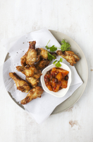 Chicken legs with a spicy fruit salsa