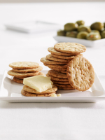 Round crackers with cheese and olives
