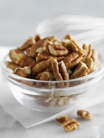 Shelled pecan nuts in a glass bowl