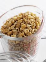 Chopped walnuts in a measuring jug