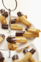 Piped biscuits with chocolate glaze