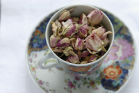 Dried rose flowers in an English teacup
