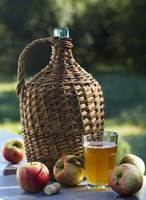 Apple must in a demijohn, a glass of apple juice and fresh a