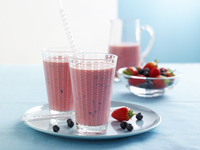Strawberry and blueberry smoothies and fresh berries