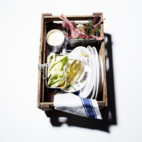 A picnic basket for a barbecue: lamb chops, raw fennel and m