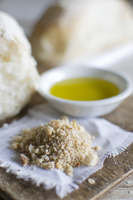 Dukkah, white bread and a bowl of olive oil