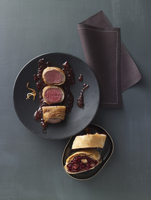 Saddle of venison wrapped in potato with mulled wine and oni