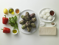 Ingredients for goat's cheese sandwiches on an artichoke sal
