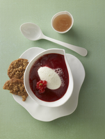 Red berry jelly soup with buttermilk dumplings and oat biscu