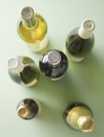 Various bottles of wine and a champagne bottle seen from abo